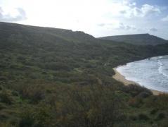 maltese cliffs erosion ghajn tuffieha bay malta cctv