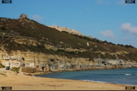 Gnejna Bay beach Malta huts in cliff Manikata Mgarr